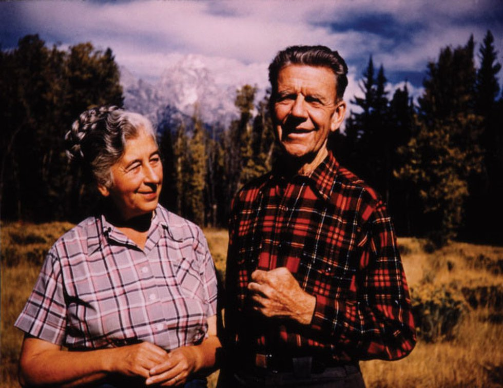 Mardy Murie (left) and Olaus Murie (right) by their home in front of Grand Tetons, 1953.