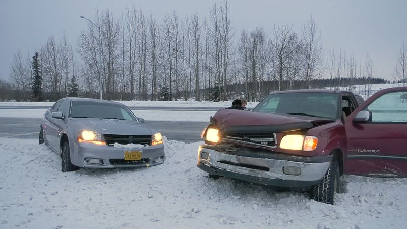 Two vehicles are high centered in a snow bank on Geist Road in what was allegedly a hit-and-run...