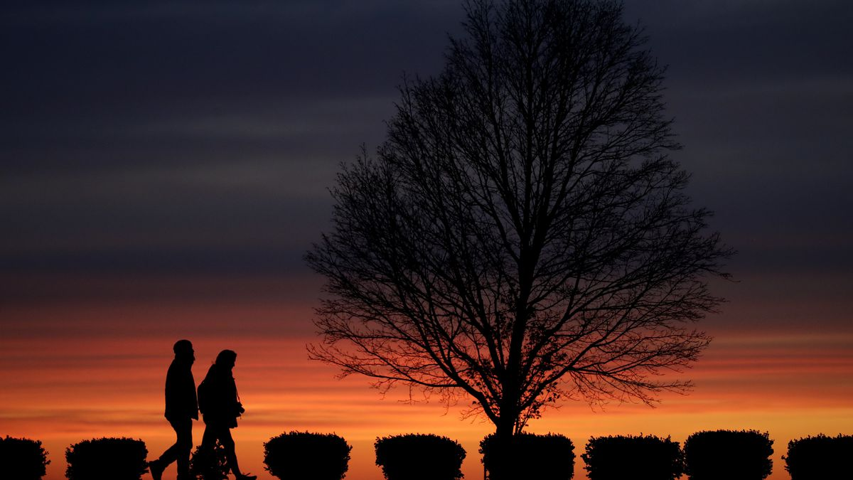 FILE - In this Monday, April 13, 2020 file photo, a couple walks alone in a Kansas City, Mo.,...