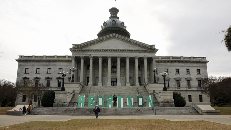 A group who opposes a bill that would ban almost all abortions in South Carolina put up a sign...