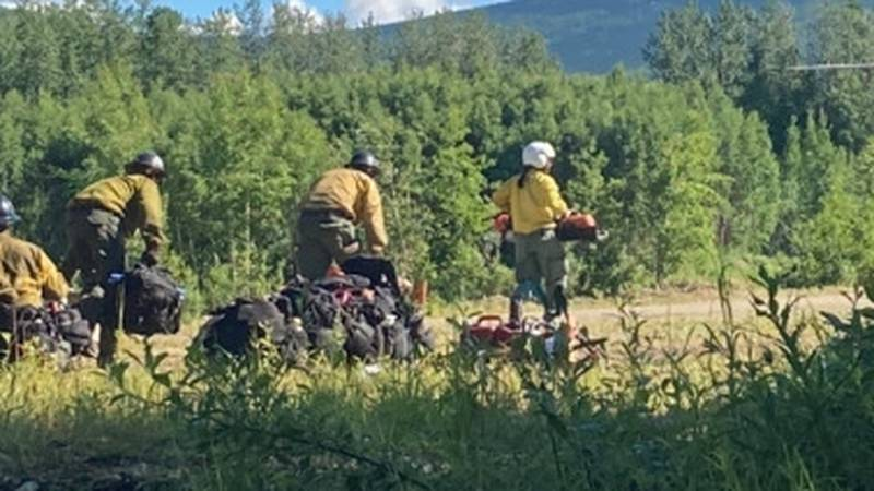 Members of the Yukon Fire Crew load onto a Helicopter to head to the Haystack fire north of...