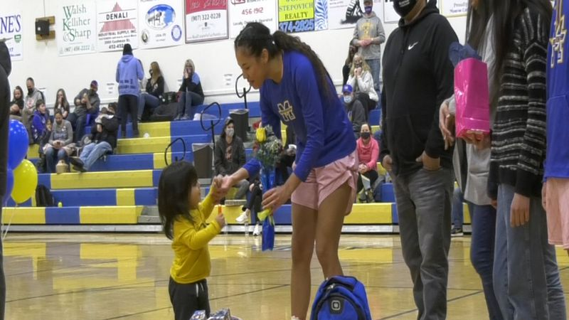 Matteah Felix receives flowers from younger brother on Senior Night (March 6, 2021).