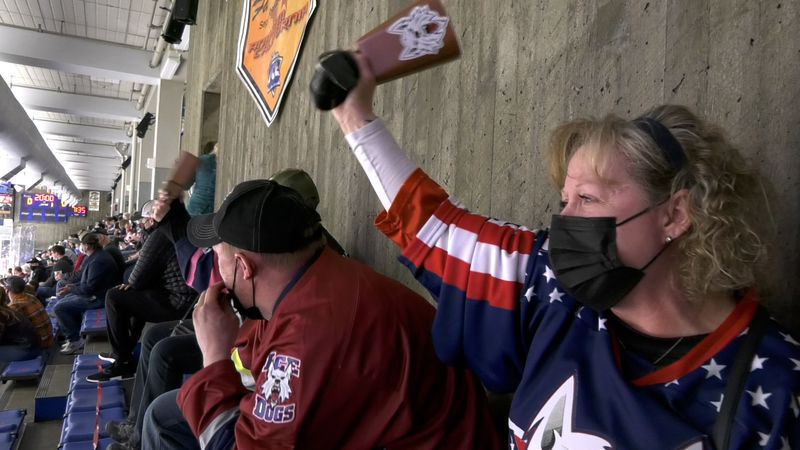 Ice Dogs fan Shawn Schott cheers on her team as they play for the first time in Fairbanks in...
