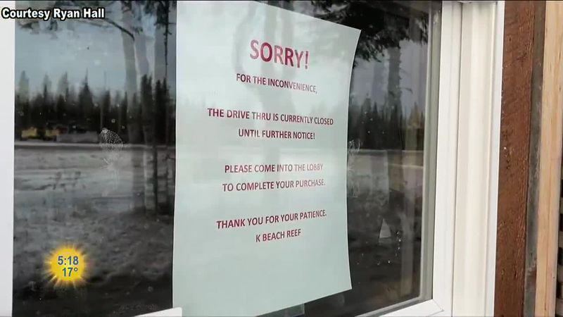 A sign in the drive-thru window at K Beach Reef explaining that they can't deliver curbside...
