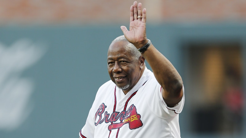 Former Atlanta Braves' Hank Aaron is honored during a ceremony before a baseball game between...