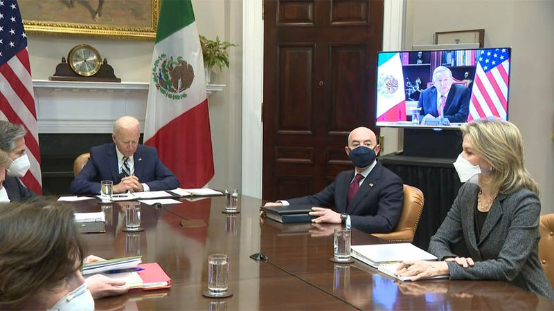 President Joe Biden, right, attends a virtual meeting with Mexican President Andres Manuel...
