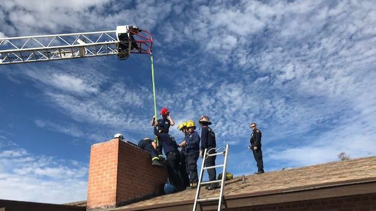 "Firefighters had to pull him from above with a crane and push him from below before ""up the chimney he rose."" (Source: Tucson Fire Department)"