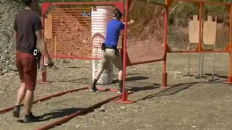 The club members of Fairbanks Alaska Shooters, an affiliate of USPSA running through a match...