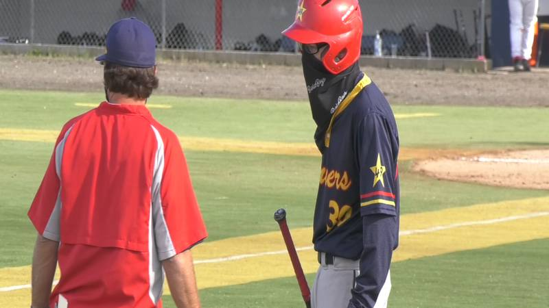 Goldpanners newcomer Bobby Brown chats with field manager Anthony Ferro during game one of a...