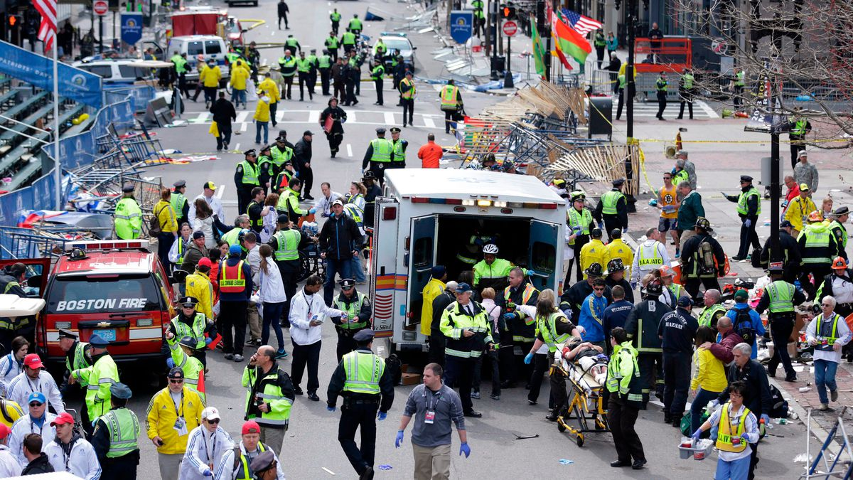 FILE - In this April 15, 2013, file photo, medical workers aid injured people following an explosion at the finish line of the 2013 Boston Marathon in Boston. Twin bombs near the finish line of one of the world's most storied races killed three people and injured 260 others, many of whom lost their legs.