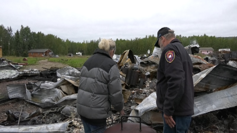 Don and Virginia Mckee look upon the remains of their home.