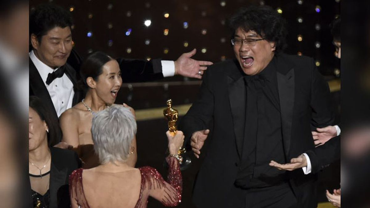 """Bong Joon Ho, right, reacts as he is presented with the award for best picture for """"Parasite"""" from presenter Jane Fonda at the Oscars on Sunday, Feb. 9, 2020, at the Dolby Theatre in Los Angeles. Looking on from left are Kang-Ho Song and Kwak Sin Ae. (Source: AP Photo/Chris Pizzello)"""