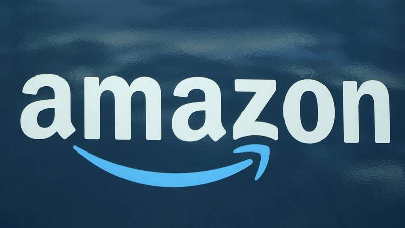 FILE - In this Oct. 1, 2020 file photo, an Amazon logo appears on an Amazon delivery van in...