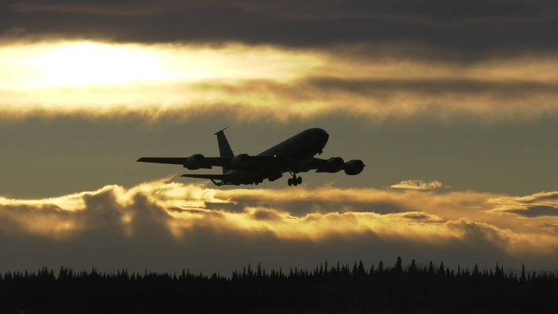 A KC-135 departs Eielson Air Force Base with National Guard members from the to pick up...