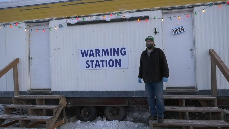 Roscoe Britton, Program Director for non-profit No Limits standing in front of new warming...