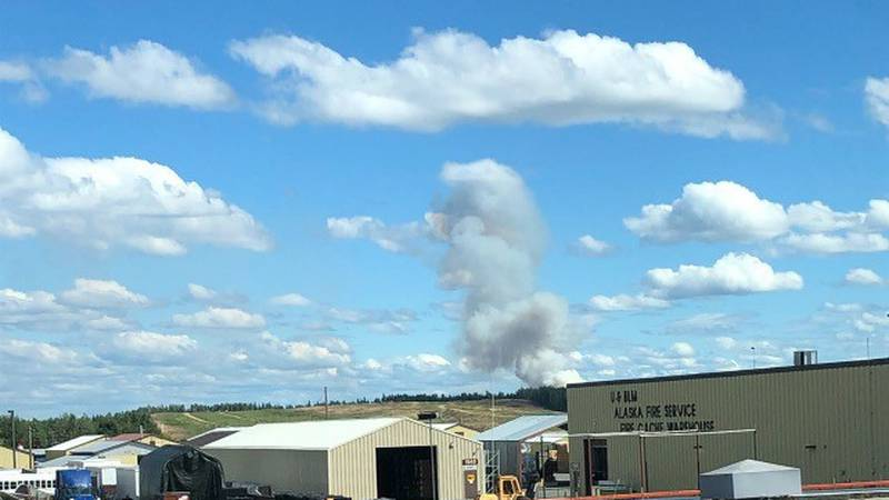 A smoke column from the Brock Road Fire is seen behind the BLM Alaska Fire Service warehouse on...