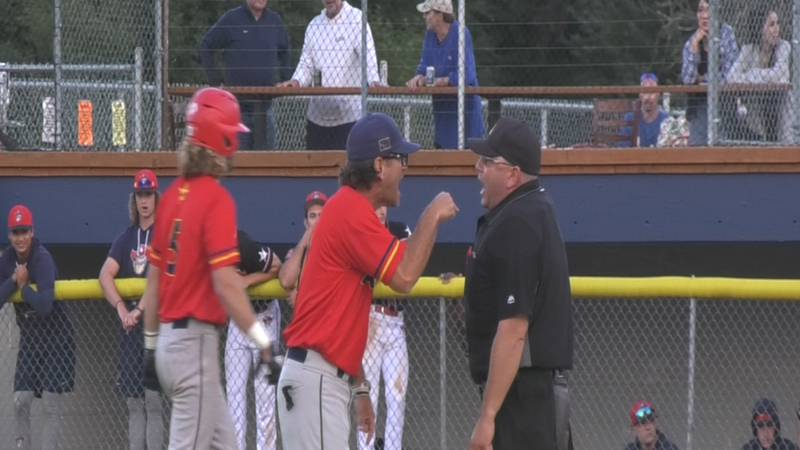 Goldpanners Field Manager Anthony Ferro disputes a call in the 11th inning of Alaska's 7-5 loss...