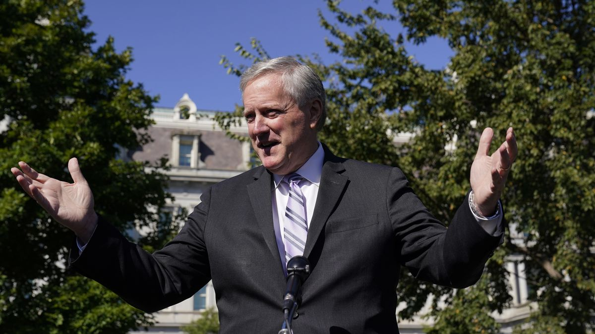White House Chief of Staff Mark Meadows speaks with reporters at the White House, Friday, Oct....