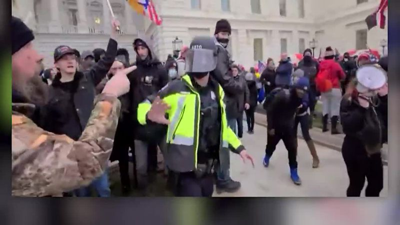 The Department of Justice released a video that shows one of the Jan. 6 rioters assaulting a...
