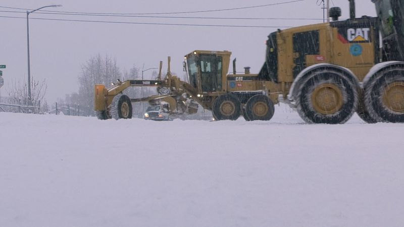 City of Fairbanks graders are seen plowing snow off of Airport Road in Fairbanks.