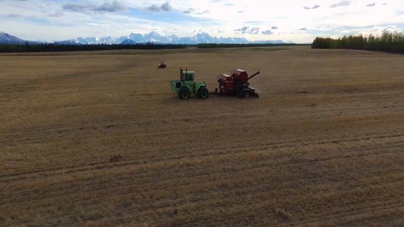 The Wrigley family farm uses a no-till tractor to plant seeds of barley.