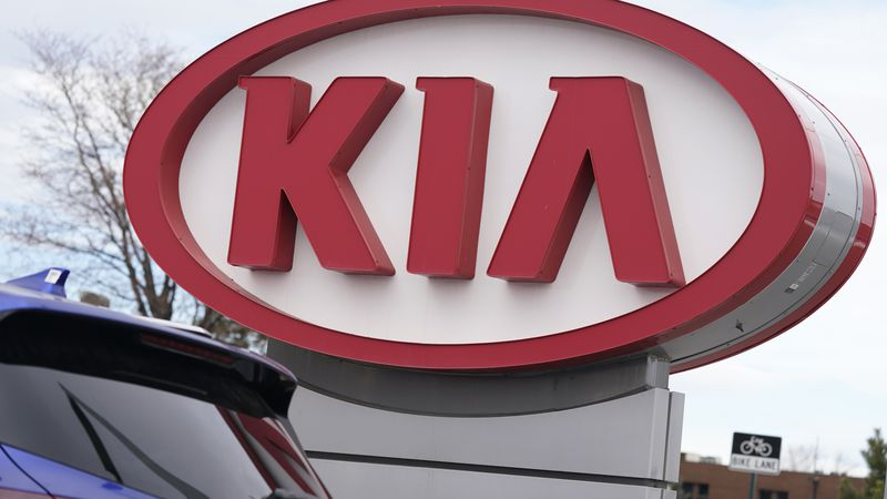 The company logo stands over a row of unsold 2021 Seltos models at a Kia dealership Sunday,...