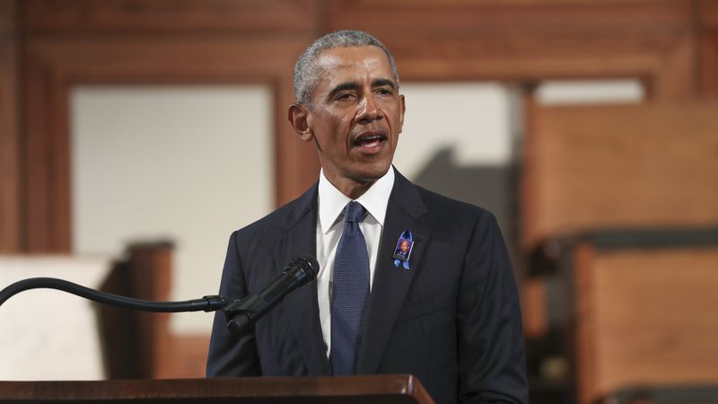 Former President Barack Obama, addresses the service during the funeral for the late Rep. John...