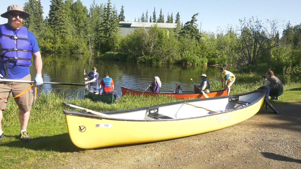 Volunteers at Noyes Slough used canoes to help navigate the waterway to pick up trash.