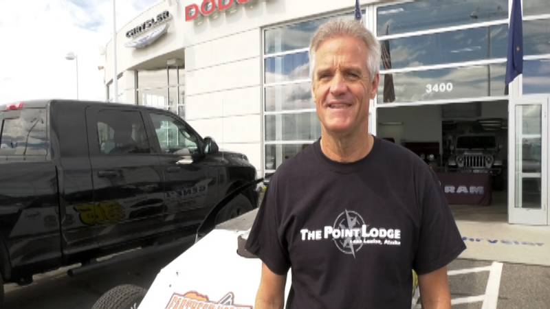 Former NASCAR driver Kenny Wallace stands in front of the modified vehicle he will be driving...