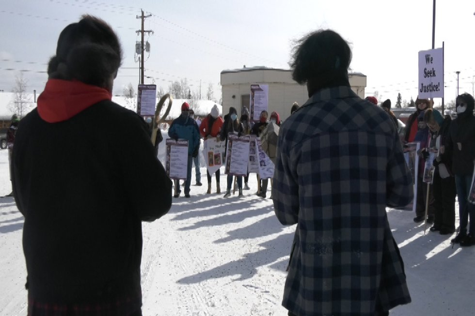 Community members gather for a song and prayer at the opening of Friday's Missing Person rally.