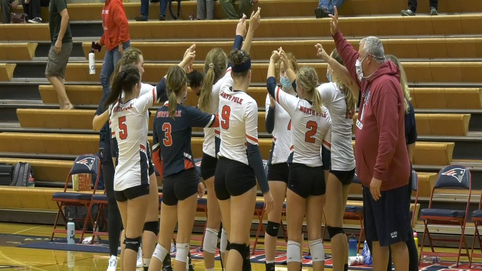 North Pole celebrates after winning a close five-set winner over the Monroe Catholic Rams.