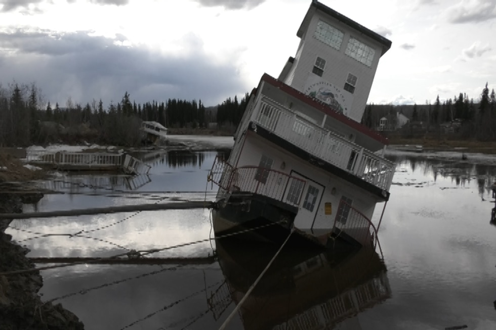Partially submerged Tanana Chief gift shop.