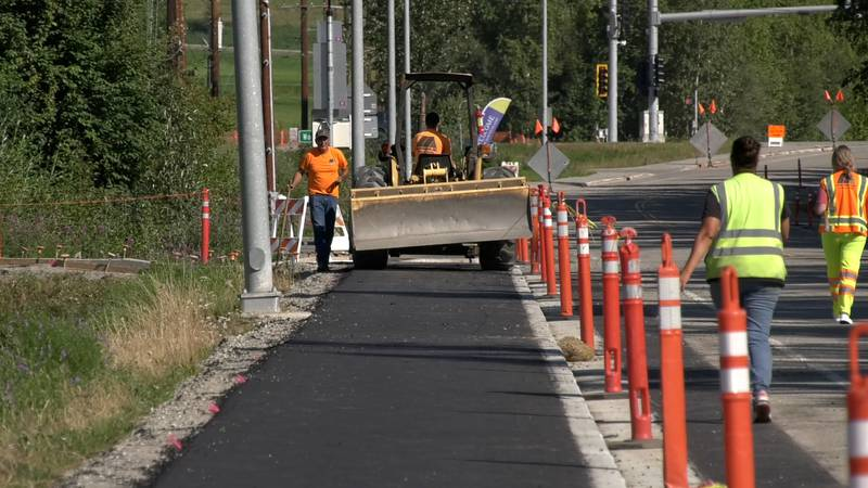 Crews work to finish a portion of sidewalk in front of University Park Elementary School on...