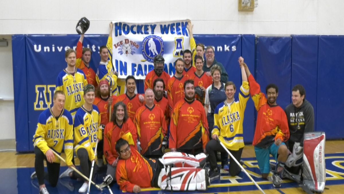 Tanana Valley Special Olympics and the Alaska Nanooks pose after playing floor hockey at UAF. (KTVF/Aaron Walling/March 4, 2020)