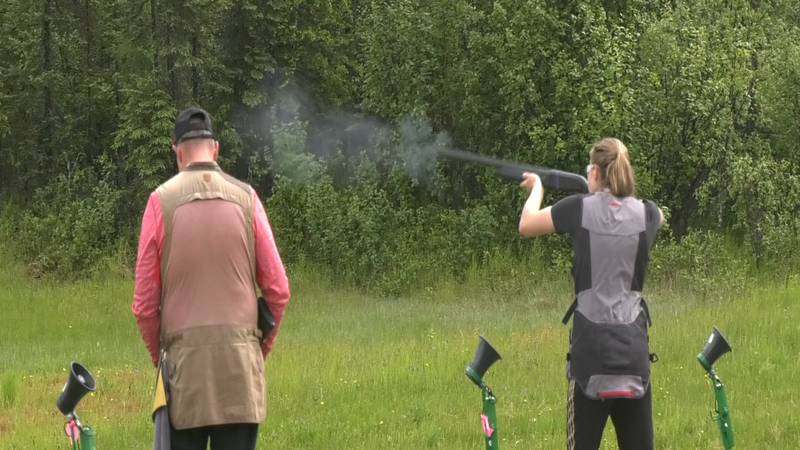 Competitors at the Alaska State PITA Trap Shoot line up for the single's event Saturday.