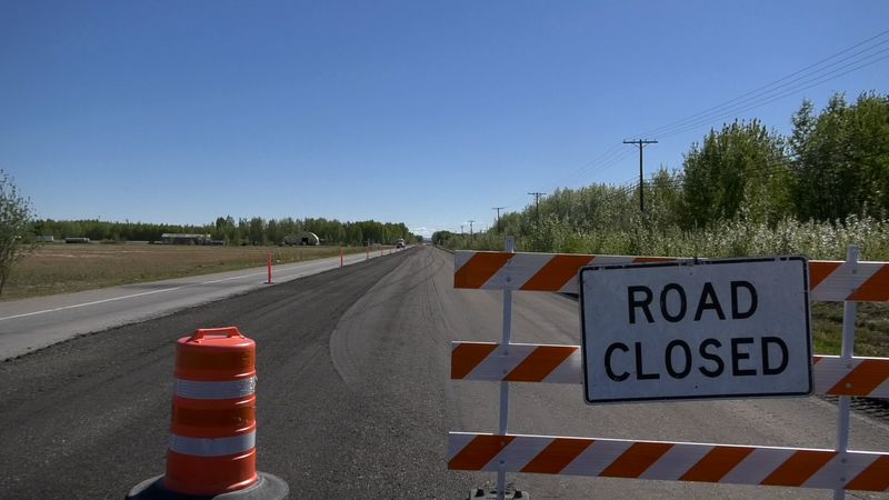 'Road closed' signs are common sights around Fairbanks during the summer months while crews...