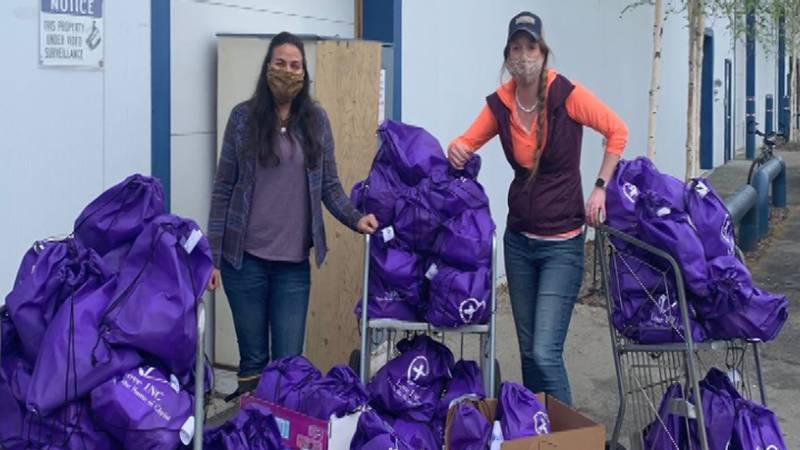 Volunteers from Love INC hand out toiletry bags to those in need.