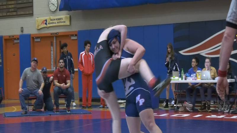 North Pole's Kristy Massey takes down a Wasilla wrestler at the annual John Tobin Tournament in...