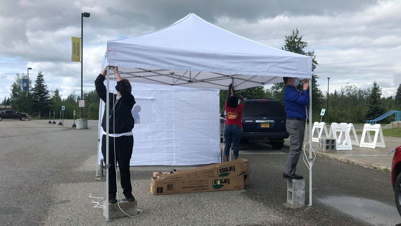 Volunteers set up tents for free COVID-19 testing at the Carlson Center. (Sara Tewksbury/KTVF)