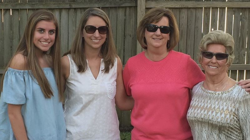 Joan Hill, on the far right, is pictured here with her daughter in the pink shirt, her...