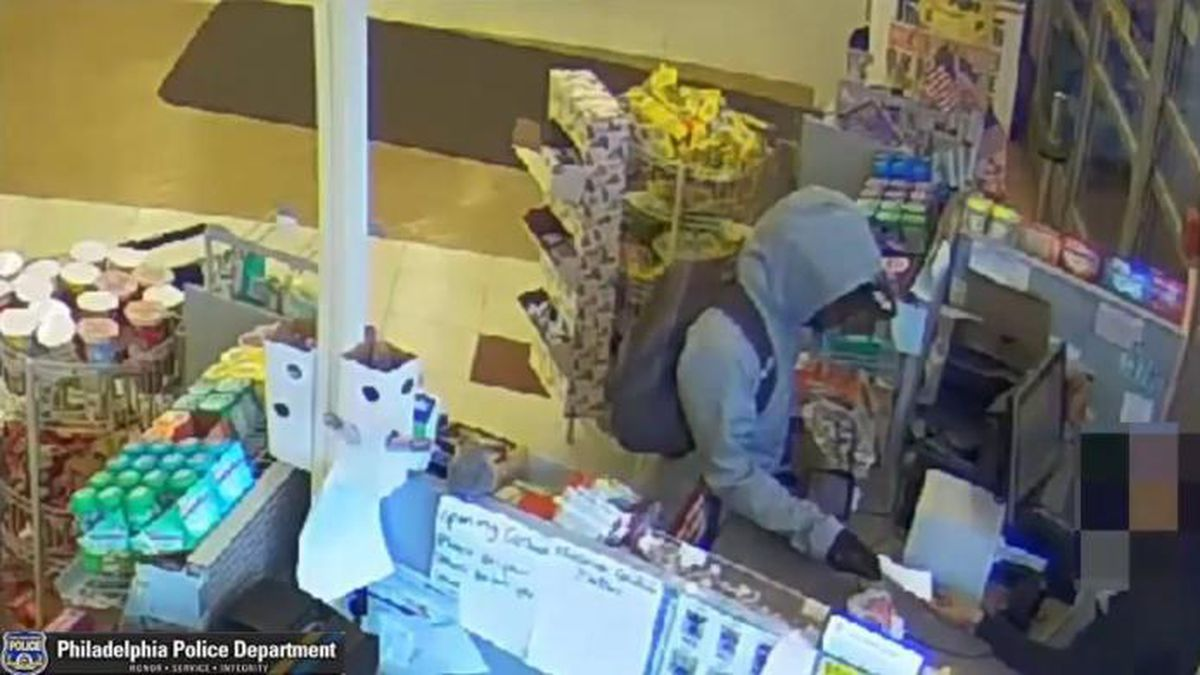 The suspect of a robbery in Philadelphia was caught on camera handing a note to a cashier asking for money, police said. (Source: Philadelphia Police Department)