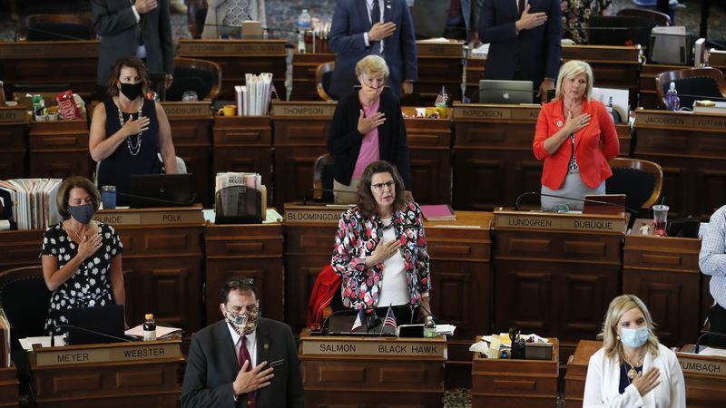 In this June 3, 2020, file photo, State Representatives stand at their desks during the Pledge...