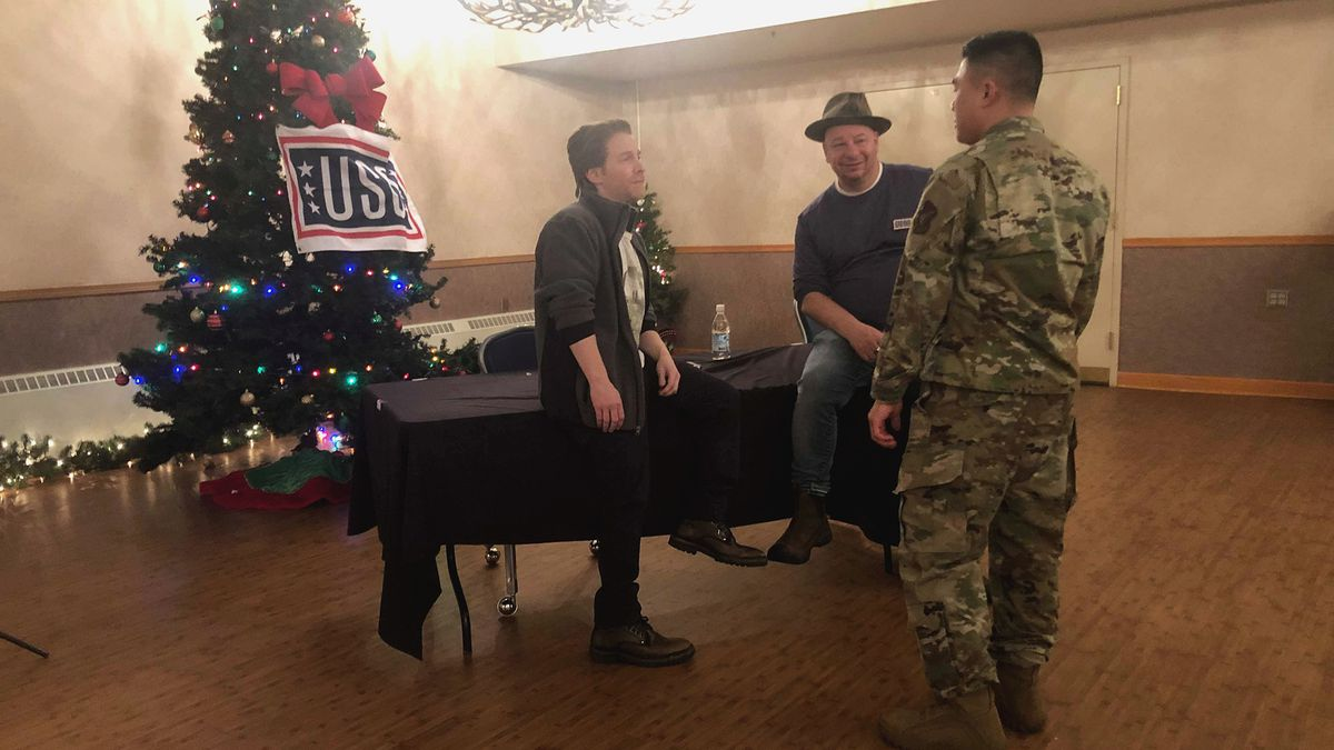 Comedians Seth Green and Jeff Ross talk to an airman at Eielson Air Force Base. (Sara Tewksbury/KTVF).