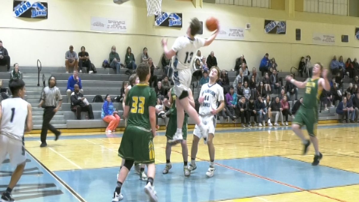 Dean Silva grabs the offensive rebound against Delta Junction. (February 19, 2020/ KTVF)