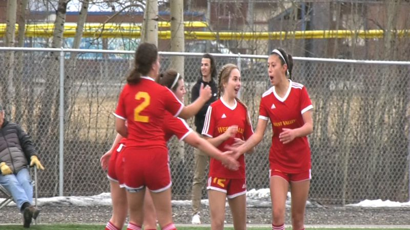 West Valley senior Aubrey Stacy celebrates with teammates after pocketing a second half goal in...