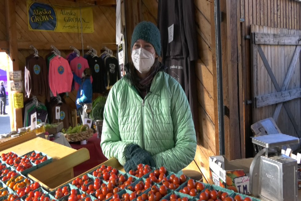 Christine St. Pierre smiles in front of her produce stand at the Tanana Valley Farmer's...