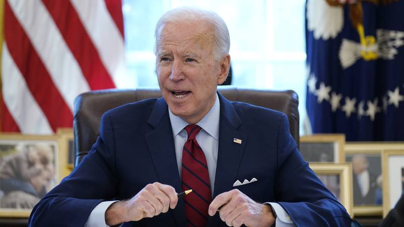 In this Jan. 28, 2021, file photo, President Joe Biden signs a series of executive orders in...