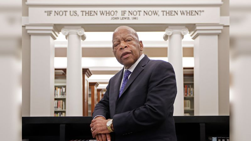 Rep. John Lewis, D-Ga., poses for a photograph under a quote of his that is displayed in the...