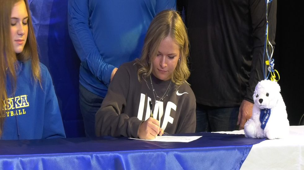 Kinley Erickson signs her national letter of intent to the Alaska Nanooks.