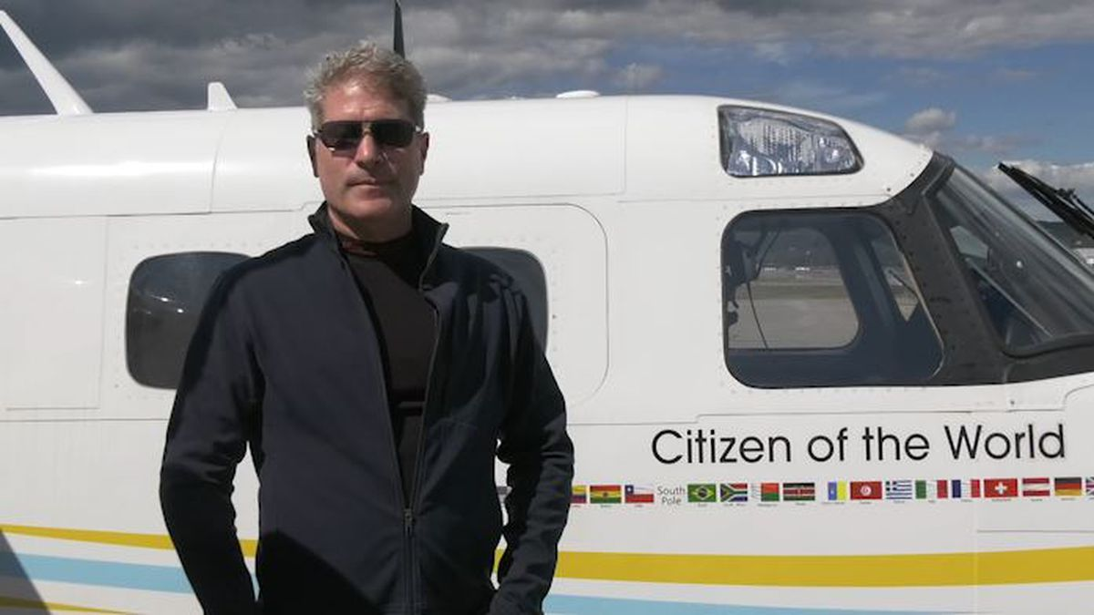 Robert DeLaurentis stands in front on his Gulf Stream airplane before heading off towards the south Pole.